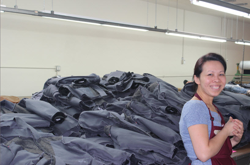 Channy Hiersche, posing by the many jackets ready for bagging.